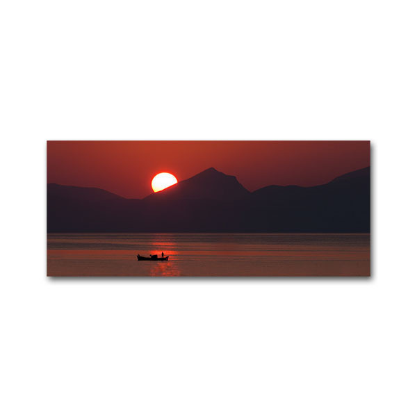 A fishing boat at sunrise at the Argolic gulf close to Astros Kynourias, Arcadia, Greece.