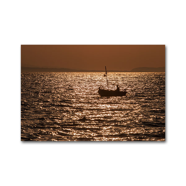 A fishing boat on sunrise at Tyros. Arcadia, Peloponnese, Greece