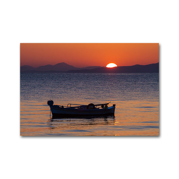 Fishing boat on sunrise. Tyros, Arcadia, Peloponnese, Greece