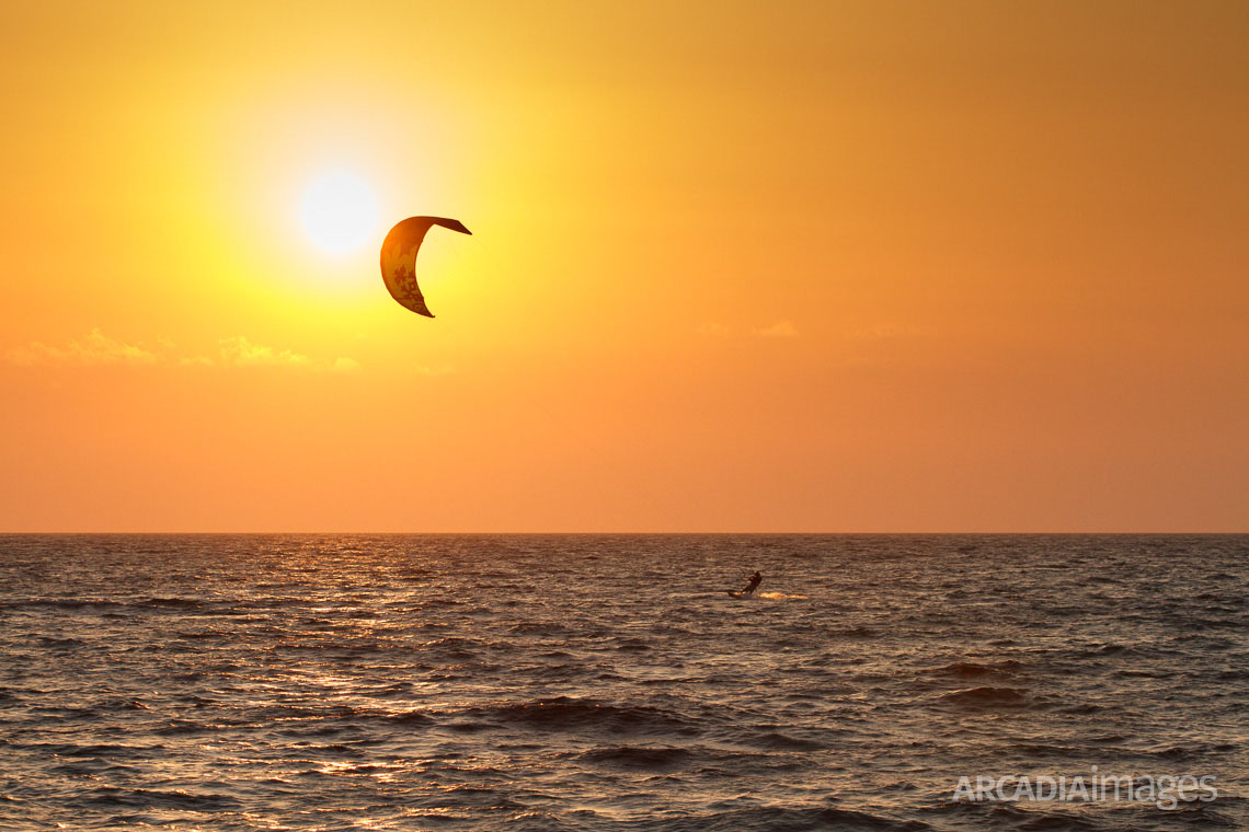 A Kitesurfer at Navarino Bay, close to Gialova beach. Gialova, Messenia, Peloponnese