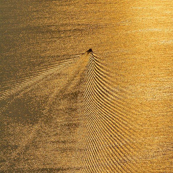 Fine Art Print - A boat sails at the Epidavros gulf during sunrise. Argolis, Peloponnese