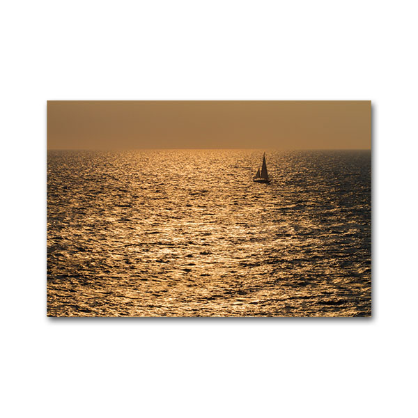 A sailboat sailing close to cape Maleas during sunrise, Laconia, Peloponnese