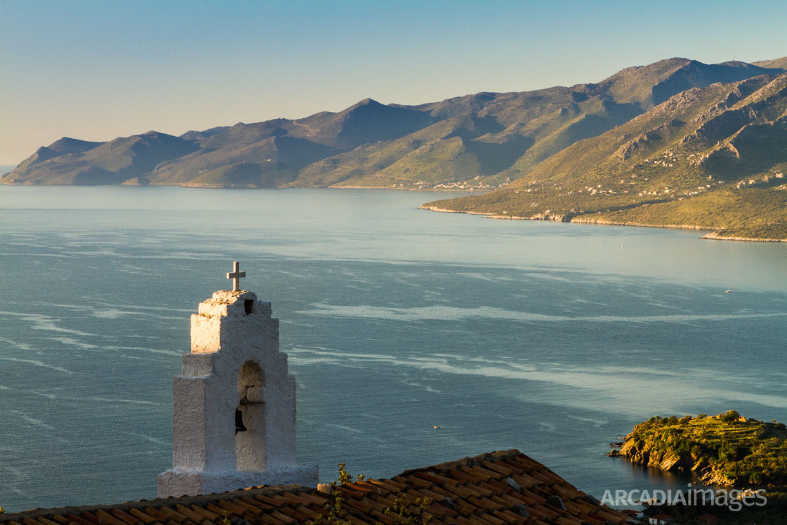 The bell of a church in the abandoned village of Goneas over Kotronas. East Mani in the background. Laconia, Peloponnese