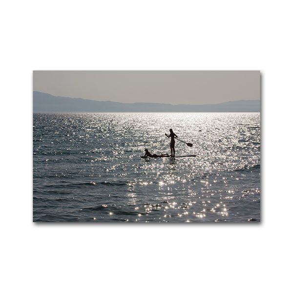 Girls on paddleboard at Kalamata, Messinia, Peloponnese, Greece