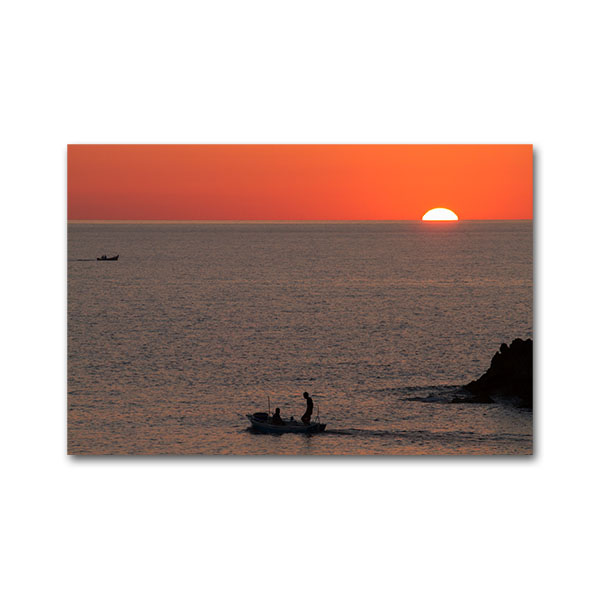 Fishermen at Vromoneri during sunset. Messenia, Peloponnese, Greece