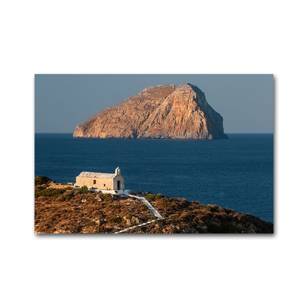 Church at Kythera (Cerigo) island and Chytra islet in the background. In Mythology, this islet is what remained from the genitals of Uranus after he was killed by his son Cronus. After this Aphrodite emmerged from the sea waves. Kythera island, Greece